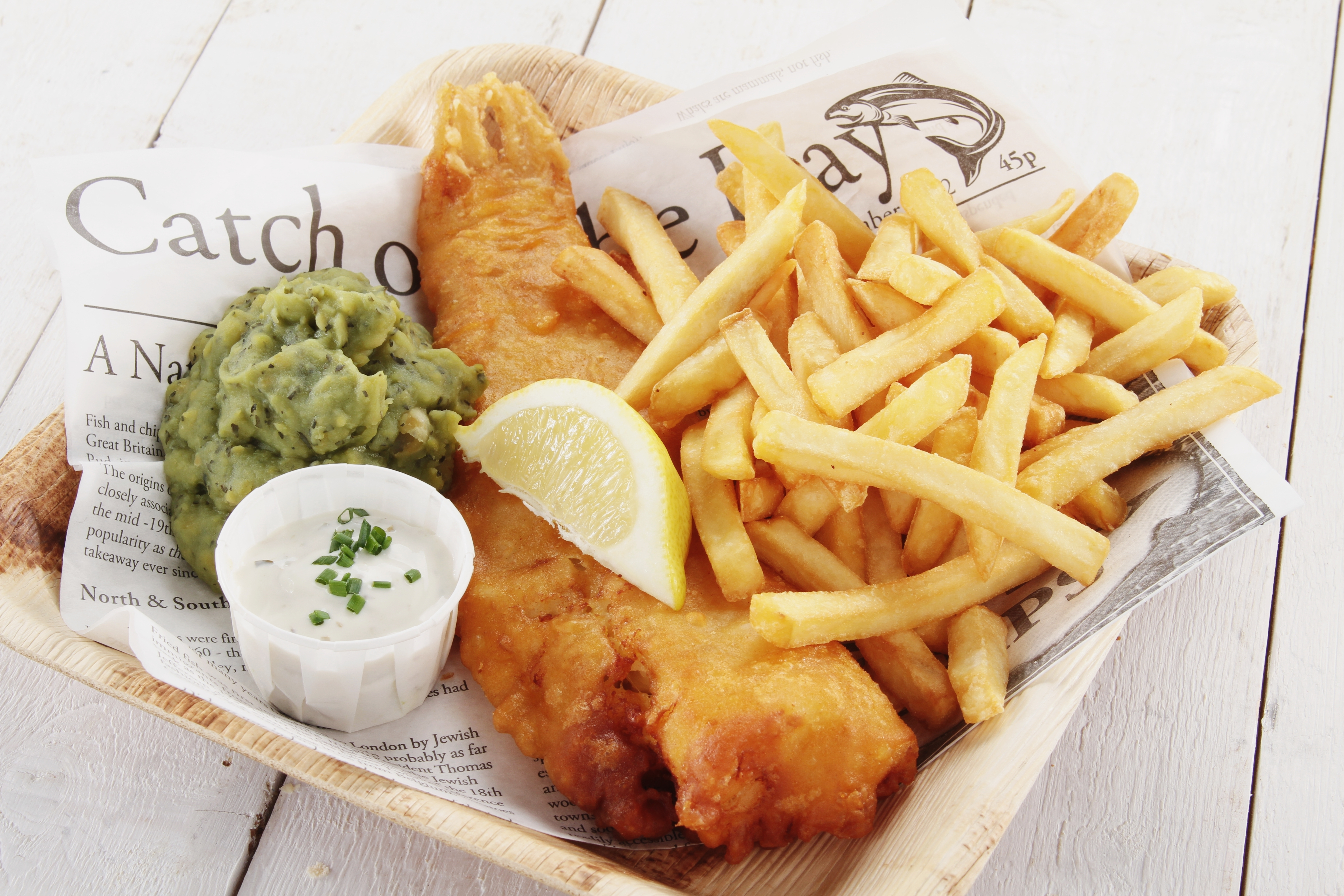 fish, chips and mushy peas in a box