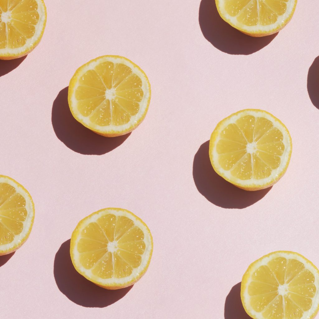 sliced lemons on a pale pink background
